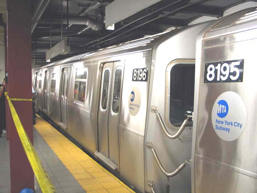 (73k, 853x640)<br><b>Country:</b> United States<br><b>City:</b> New York<br><b>System:</b> New York City Transit<br><b>Line:</b> BMT Canarsie Line<br><b>Location:</b> 8th Avenue<br><b>Route:</b> L<br><b>Car:</b> R-143 (Kawasaki, 2001-2002) 8196 <br><b>Photo by:</b> Michael Pompili<br><b>Date:</b> 4/18/2004<br><b>Viewed (this week/total):</b> 13 / 3672