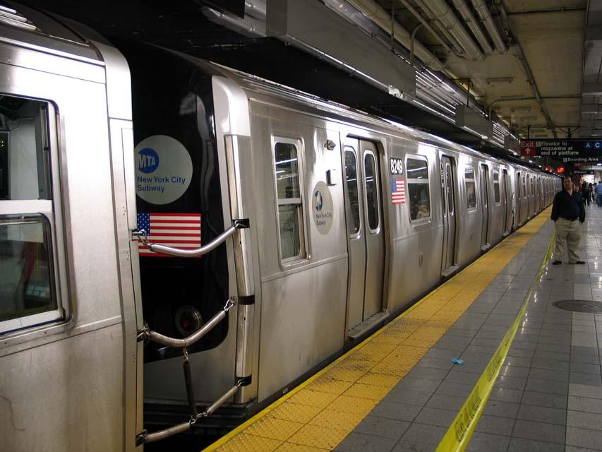 (94k, 853x640)<br><b>Country:</b> United States<br><b>City:</b> New York<br><b>System:</b> New York City Transit<br><b>Line:</b> BMT Canarsie Line<br><b>Location:</b> 8th Avenue<br><b>Route:</b> L<br><b>Car:</b> R-143 (Kawasaki, 2001-2002) 8249 <br><b>Photo by:</b> Michael Pompili<br><b>Date:</b> 4/18/2004<br><b>Viewed (this week/total):</b> 4 / 3907