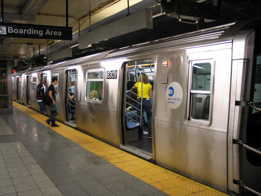 (93k, 853x640)<br><b>Country:</b> United States<br><b>City:</b> New York<br><b>System:</b> New York City Transit<br><b>Line:</b> BMT Canarsie Line<br><b>Location:</b> 8th Avenue<br><b>Route:</b> L<br><b>Car:</b> R-143 (Kawasaki, 2001-2002) 8309 <br><b>Photo by:</b> Michael Pompili<br><b>Date:</b> 4/18/2004<br><b>Viewed (this week/total):</b> 4 / 5143