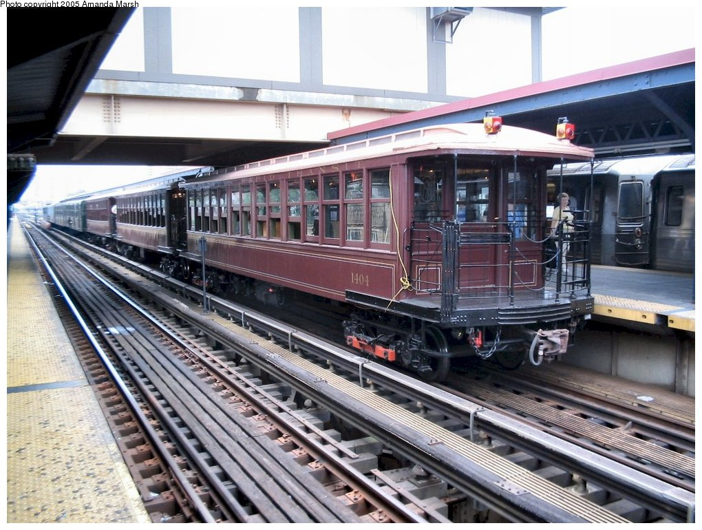 (190k, 1020x770)<br><b>Country:</b> United States<br><b>City:</b> New York<br><b>System:</b> New York City Transit<br><b>Line:</b> BMT Brighton Line<br><b>Location:</b> Brighton Beach<br><b>Route:</b> Fan Trip<br><b>Car:</b> BMT Elevated Gate Car 1404 <br><b>Photo by:</b> Amanda Marsh<br><b>Date:</b> 7/18/2004<br><b>Viewed (this week/total):</b> 1 / 2510