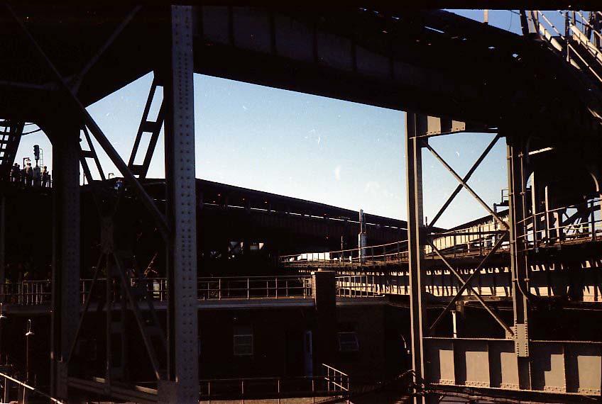(77k, 848x570)<br><b>Country:</b> United States<br><b>City:</b> New York<br><b>System:</b> New York City Transit<br><b>Line:</b> BMT Nassau Street-Jamaica Line<br><b>Location:</b> Broadway/East New York (Broadway Junction)<br><b>Photo by:</b> Stuart Gitlow<br><b>Date:</b> 9/11/1977<br><b>Notes:</b> Broadway Junction - Fulton El yard leads/trackways.<br><b>Viewed (this week/total):</b> 4 / 2595