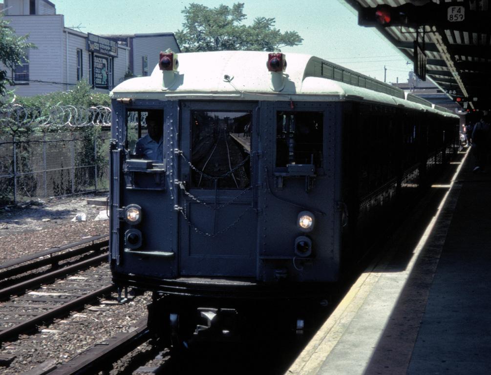 (273k, 1005x768)<br><b>Country:</b> United States<br><b>City:</b> New York<br><b>System:</b> New York City Transit<br><b>Line:</b> IND Rockaway Line<br><b>Location:</b> Rockaway Park/Beach 116th Street<br><b>Route:</b> Fan Trip<br><b>Car:</b> Low-V (Museum Train) 5443 <br><b>Photo by:</b> Chris Leverett<br><b>Date:</b> 7/6/1996<br><b>Viewed (this week/total):</b> 0 / 2319