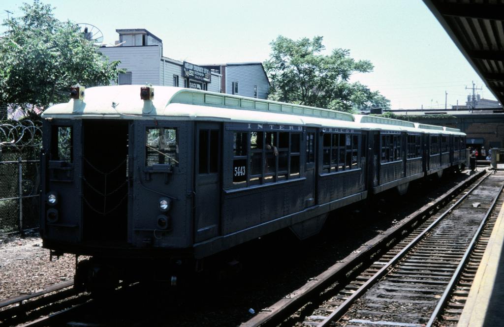 (265k, 1024x665)<br><b>Country:</b> United States<br><b>City:</b> New York<br><b>System:</b> New York City Transit<br><b>Line:</b> IND Rockaway Line<br><b>Location:</b> Rockaway Park/Beach 116th Street<br><b>Route:</b> Fan Trip<br><b>Car:</b> Low-V (Museum Train) 5443 <br><b>Photo by:</b> Chris Leverett<br><b>Date:</b> 7/6/1996<br><b>Viewed (this week/total):</b> 0 / 2584