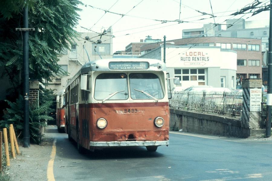 (91k, 900x600)<br><b>Country:</b> United States<br><b>City:</b> Boston, MA<br><b>System:</b> MBTA Boston<br><b>Line:</b> MBTA Trolleybus (71,72,73)<br><b>Location:</b> Harvard Square<br><b>Car:</b> MBTA Trolleybus 8483 <br><b>Photo by:</b> Harv Kahn<br><b>Date:</b> 7/10/1976<br><b>Viewed (this week/total):</b> 0 / 1341
