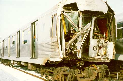 (25k, 485x321)<br><b>Country:</b> United States<br><b>City:</b> New York<br><b>System:</b> New York City Transit<br><b>Location:</b> East New York Yard/Shops<br><b>Car:</b> R-42 (St. Louis, 1969-1970) 4664 <br><b>Photo by:</b> Trevor Logan<br><b>Notes:</b> 1995 Williamsburg Bridge accident<br><b>Viewed (this week/total):</b> 7 / 28050