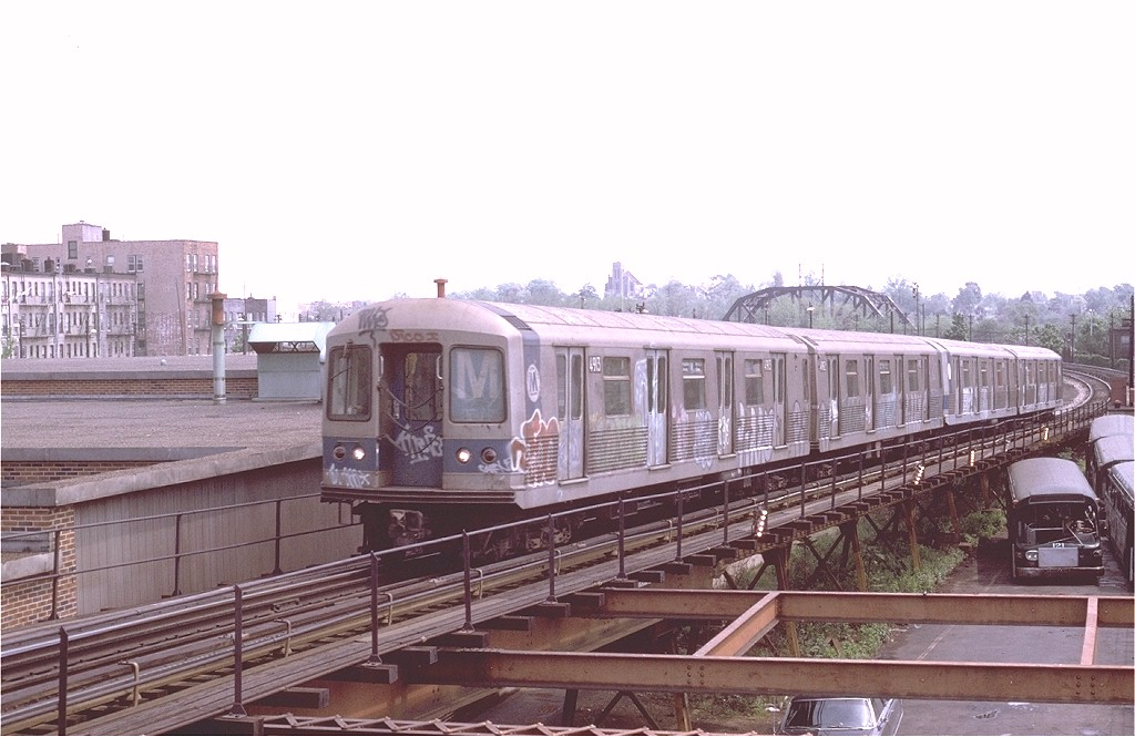 (166k, 1024x665)<br><b>Country:</b> United States<br><b>City:</b> New York<br><b>System:</b> New York City Transit<br><b>Line:</b> BMT Myrtle Avenue Line<br><b>Location:</b> Fresh Pond Road<br><b>Route:</b> M<br><b>Car:</b> R-42 (St. Louis, 1969-1970) 4913 <br><b>Photo by:</b> Joe Testagrose<br><b>Date:</b> 5/18/1975<br><b>Viewed (this week/total):</b> 0 / 5836