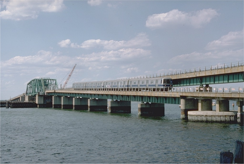 (171k, 1024x691)<br><b>Country:</b> United States<br><b>City:</b> New York<br><b>System:</b> New York City Transit<br><b>Line:</b> IND Rockaway Line<br><b>Location:</b> South Channel Bridge<br><b>Car:</b> R-44 (St. Louis, 1971-73) 104 <br><b>Photo by:</b> Ed McKernan<br><b>Collection of:</b> Joe Testagrose<br><b>Date:</b> 6/19/1977<br><b>Viewed (this week/total):</b> 0 / 6227