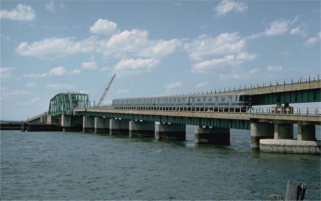 (164k, 1024x641)<br><b>Country:</b> United States<br><b>City:</b> New York<br><b>System:</b> New York City Transit<br><b>Line:</b> IND Rockaway Line<br><b>Location:</b> South Channel Bridge<br><b>Car:</b> R-44 (St. Louis, 1971-73) 244 <br><b>Photo by:</b> Ed McKernan<br><b>Collection of:</b> Joe Testagrose<br><b>Date:</b> 6/19/1977<br><b>Viewed (this week/total):</b> 0 / 4251