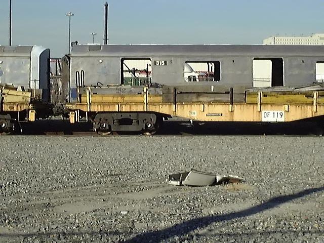 (74k, 640x480)<br><b>Country:</b> United States<br><b>City:</b> New York<br><b>System:</b> New York City Transit<br><b>Line:</b> South Brooklyn Railway<br><b>Location:</b> SBK Yard (2nd Ave at 38th St.) (SBK)<br><b>Car:</b> R-44 (St. Louis, 1971-73) 315 <br><b>Photo by:</b> Trevor Logan<br><b>Date:</b> 9/2000<br><b>Notes:</b> Bush Terminal Scrapyard<br><b>Viewed (this week/total):</b> 2 / 14919