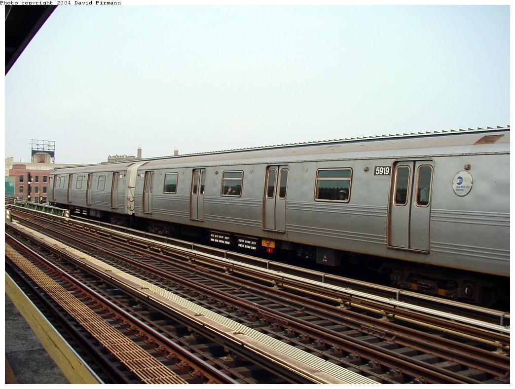 (130k, 1044x788)<br><b>Country:</b> United States<br><b>City:</b> New York<br><b>System:</b> New York City Transit<br><b>Line:</b> BMT Culver Line<br><b>Location:</b> Ditmas Avenue<br><b>Route:</b> F<br><b>Car:</b> R-46 (Pullman-Standard, 1974-75) 5919 <br><b>Photo by:</b> David Pirmann<br><b>Date:</b> 8/27/2000<br><b>Viewed (this week/total):</b> 1 / 3349