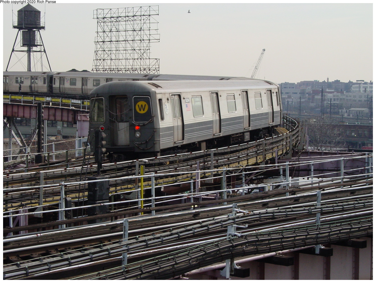 (475k, 1220x920)<br><b>Country:</b> United States<br><b>City:</b> New York<br><b>System:</b> New York City Transit<br><b>Line:</b> BMT Astoria Line<br><b>Location:</b> Queensborough Plaza<br><b>Route:</b> N<br><b>Car:</b> R-68A (Kawasaki, 1988-1989) 5004 <br><b>Photo by:</b> Richard Panse<br><b>Date:</b> 3/7/2002<br><b>Viewed (this week/total):</b> 3 / 5559