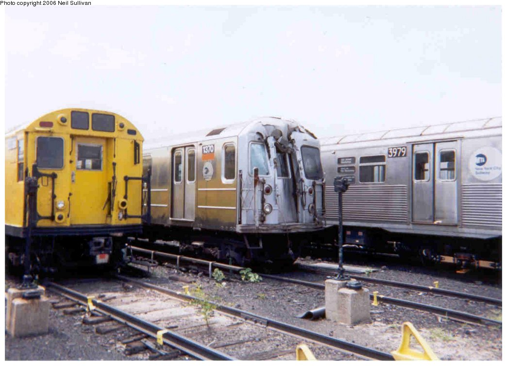 (121k, 1044x753)<br><b>Country:</b> United States<br><b>City:</b> New York<br><b>System:</b> New York City Transit<br><b>Location:</b> 207th Street Yard<br><b>Car:</b> R-62 (Kawasaki, 1983-1985) 1370 <br><b>Photo by:</b> Neil Sullivan<br><b>Date:</b> 7/2001<br><b>Notes:</b> Damaged in accident at Fordham Rd-10/25/2000<br><b>Viewed (this week/total):</b> 2 / 17342