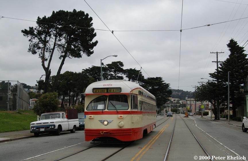 (173k, 864x564)<br><b>Country:</b> United States<br><b>City:</b> San Francisco/Bay Area, CA<br><b>System:</b> SF MUNI<br><b>Line:</b> MUNI Metro (J-Church)<br><b>Location:</b> San Jose/Sgt. John V. Young Lane<br><b>Car:</b> SF MUNI PCC (Ex-NJTransit, Ex-Twin City) (St. Louis Car Co., 1946-1947) 1079 <br><b>Photo by:</b> Peter Ehrlich<br><b>Date:</b> 10/30/2006<br><b>Notes:</b> PCC 1079 test run. San Jose/Sgt. John V. Young outbound (J-Church). Balboa Park is on the left.<br><b>Viewed (this week/total):</b> 0 / 708