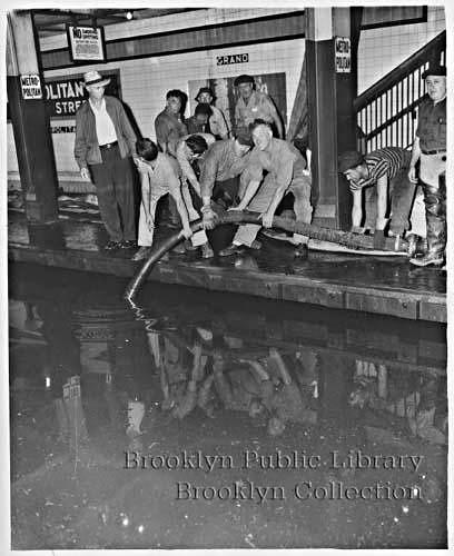 (110k, 408x500)<br><b>Country:</b> United States<br><b>City:</b> New York<br><b>System:</b> New York City Transit<br><b>Line:</b> IND Crosstown Line<br><b>Location:</b> Metropolitan Avenue/Grand Street<br><b>Collection of:</b> Brooklyn Public Library (via Herbert Maruska)<br><b>Notes:</b> Flood at Metropolitan Ave. 1950s.<br><b>Viewed (this week/total):</b> 1 / 3886