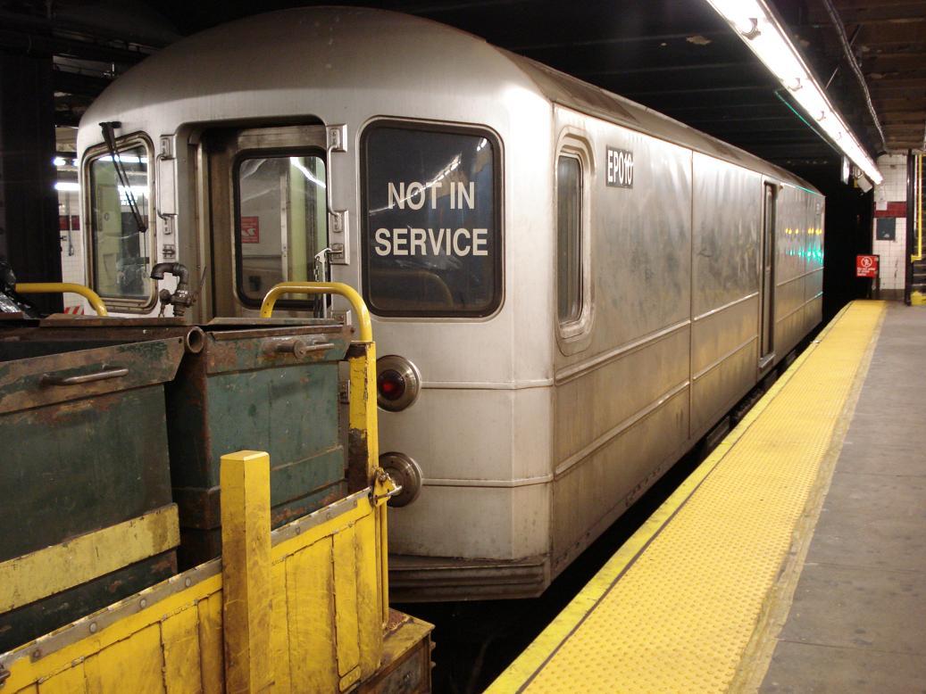 (128k, 1037x778)<br><b>Country:</b> United States<br><b>City:</b> New York<br><b>System:</b> New York City Transit<br><b>Line:</b> IND Crosstown Line<br><b>Location:</b> Church Avenue<br><b>Route:</b> Work Service<br><b>Car:</b> R-127/R-134 (Kawasaki, 1991-1996) EP010 <br><b>Photo by:</b> Michael Hodurski<br><b>Date:</b> 1/2/2007<br><b>Viewed (this week/total):</b> 5 / 3051