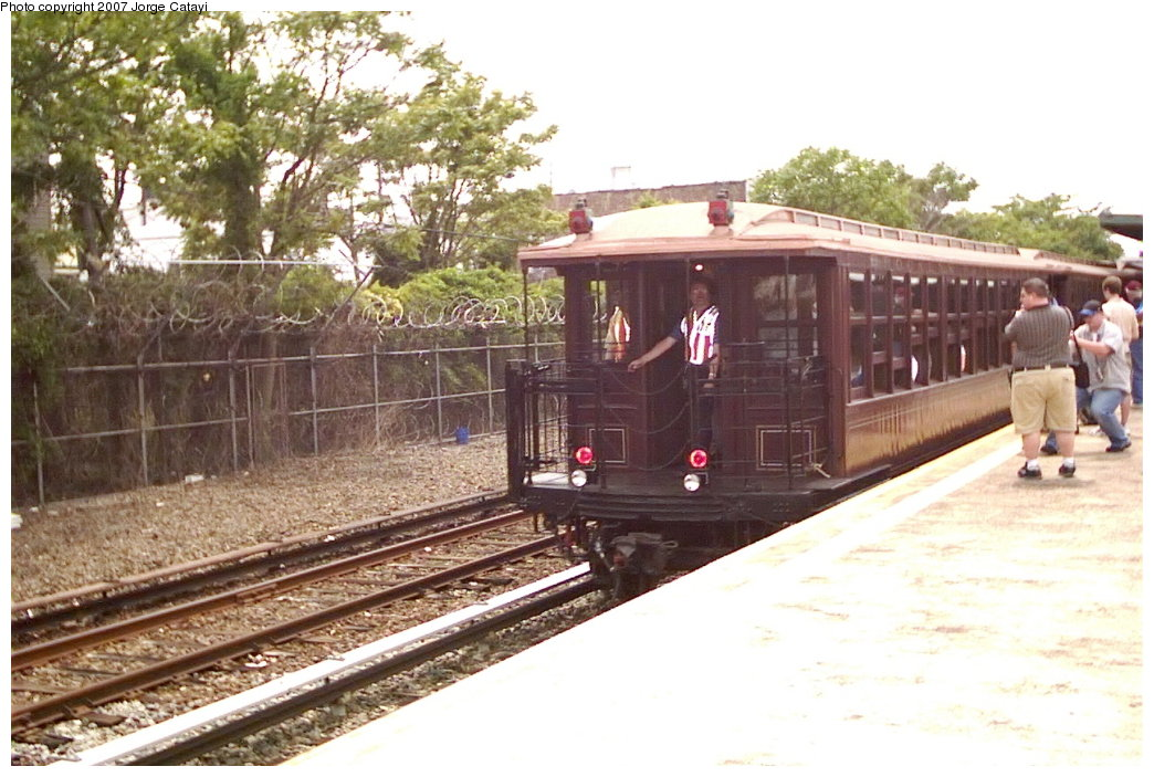 (169k, 1044x703)<br><b>Country:</b> United States<br><b>City:</b> New York<br><b>System:</b> New York City Transit<br><b>Line:</b> IND Rockaway Line<br><b>Location:</b> Rockaway Park/Beach 116th Street<br><b>Route:</b> Fan Trip<br><b>Car:</b> BMT Elevated Gate Car 1404-1273-1407 <br><b>Photo by:</b> Jorge Catayi<br><b>Date:</b> 6/17/2006<br><b>Viewed (this week/total):</b> 2 / 1843