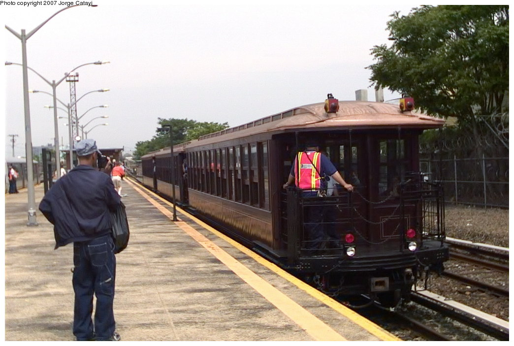 (146k, 1044x703)<br><b>Country:</b> United States<br><b>City:</b> New York<br><b>System:</b> New York City Transit<br><b>Line:</b> IND Rockaway Line<br><b>Location:</b> Rockaway Park/Beach 116th Street<br><b>Route:</b> Fan Trip<br><b>Car:</b> BMT Elevated Gate Car 1404-1273-1407 <br><b>Photo by:</b> Jorge Catayi<br><b>Date:</b> 6/17/2006<br><b>Viewed (this week/total):</b> 0 / 2179