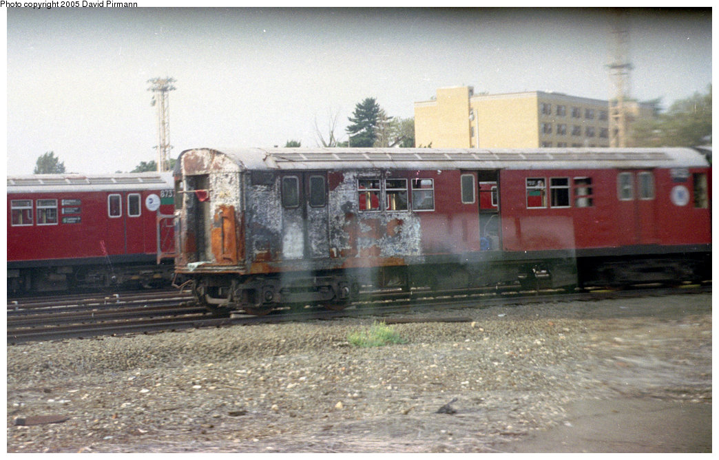 (199k, 1044x668)<br><b>Country:</b> United States<br><b>City:</b> New York<br><b>System:</b> New York City Transit<br><b>Location:</b> 239th Street Yard<br><b>Car:</b> R-33 Main Line (St. Louis, 1962-63) 9152 <br><b>Photo by:</b> David Pirmann<br><b>Date:</b> 9/13/1998<br><b>Notes:</b> R33 9152-burned in fire 2/3/1998<br><b>Viewed (this week/total):</b> 3 / 7022