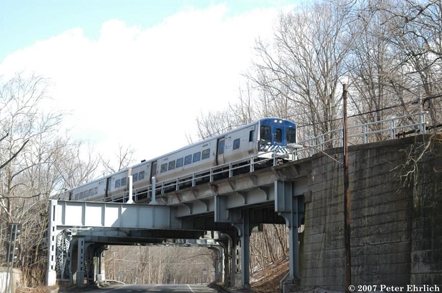 (214k, 864x574)<br><b>Country:</b> United States<br><b>System:</b> Metro-North Railroad (or Amtrak or Predecessor RR)<br><b>Line:</b> Metro North-Harlem Line<br><b>Location:</b> Croton Falls<br><b>Car:</b> MNRR M-7a EMU (Bombardier) 4042 <br><b>Photo by:</b> Peter Ehrlich<br><b>Date:</b> 3/5/2007<br><b>Notes:</b> Southbound train crossing bridge over US202 north of Croton Falls.<br><b>Viewed (this week/total):</b> 2 / 1686
