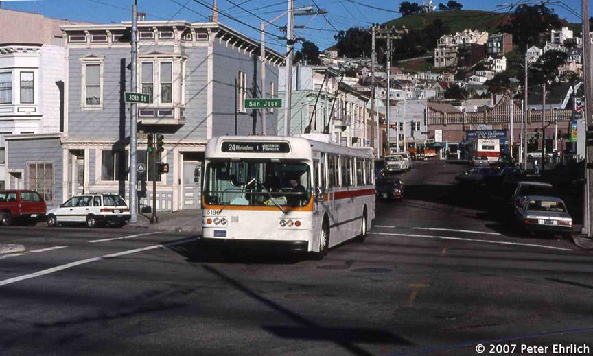 (188k, 864x519)<br><b>Country:</b> United States<br><b>City:</b> San Francisco/Bay Area, CA<br><b>System:</b> SF MUNI<br><b>Line:</b> SF MUNI Trolley Coach Routes<br><b>Car:</b> SF MUNI Trolley Coach (Flyer E800, 1975-77) 5186 <br><b>Photo by:</b> Peter Ehrlich<br><b>Date:</b> 2/20/1997<br><b>Notes:</b> 30th Street/San Jose Avenue.  24-Divisadero inbound.<br><b>Viewed (this week/total):</b> 0 / 994