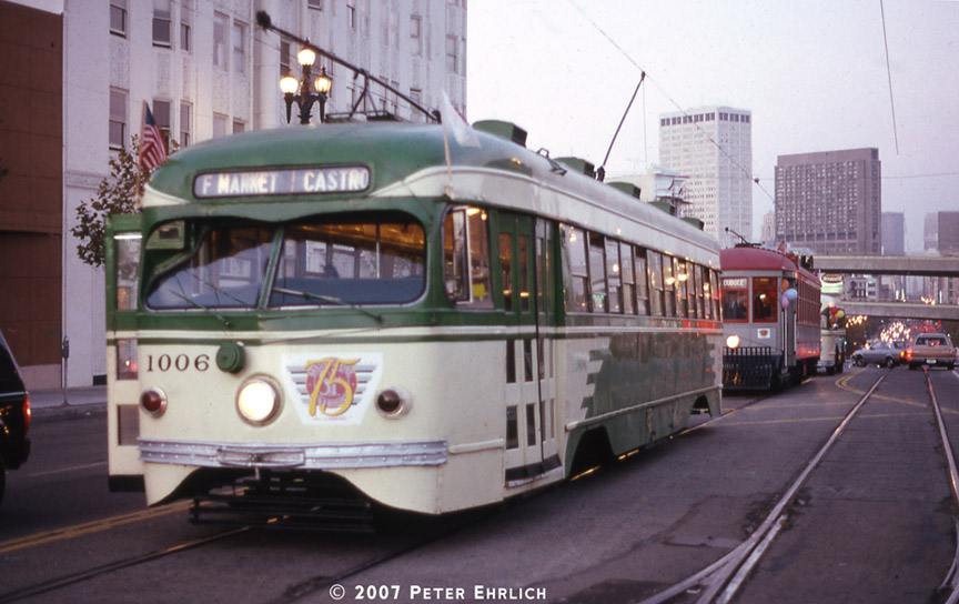 (163k, 864x544)<br><b>Country:</b> United States<br><b>City:</b> San Francisco/Bay Area, CA<br><b>System:</b> SF MUNI<br><b>Location:</b> Market/Laguna/Guerrero/Hermann<br><b>Car:</b> SF MUNI PCC Torpedo Double-End (St. Louis Car Co., 1948) 1006 <br><b>Photo by:</b> Peter Ehrlich<br><b>Date:</b> 10/16/1987<br><b>Notes:</b> Market between Laguna and Duboce outbound.  Last day Trolley Festival parade.<br><b>Viewed (this week/total):</b> 0 / 702