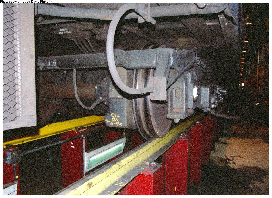 (362k, 1044x760)<br><b>Country:</b> United States<br><b>City:</b> New York<br><b>System:</b> New York City Transit<br><b>Location:</b> Coney Island Shop/Maint. & Inspection Shop<br><b>Car:</b> R-46 (Pullman-Standard, 1974-75)  <br><b>Photo by:</b> David Pirmann<br><b>Date:</b> 2/24/1996<br><b>Notes:</b> View of an R46 truck from underneath, in the inspection area<br><b>Viewed (this week/total):</b> 10 / 15661
