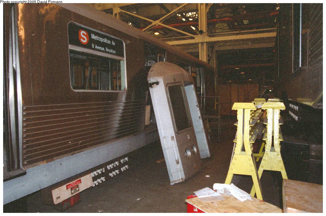 (277k, 1044x694)<br><b>Country:</b> United States<br><b>City:</b> New York<br><b>System:</b> New York City Transit<br><b>Location:</b> Coney Island Shop/Overhaul & Repair Shop<br><b>Car:</b> R-42 (St. Louis, 1969-1970) 4918 <br><b>Photo by:</b> David Pirmann<br><b>Date:</b> 2/24/1996<br><b>Notes:</b> Detached front of an R42 leaning against its body<br><b>Viewed (this week/total):</b> 4 / 14671