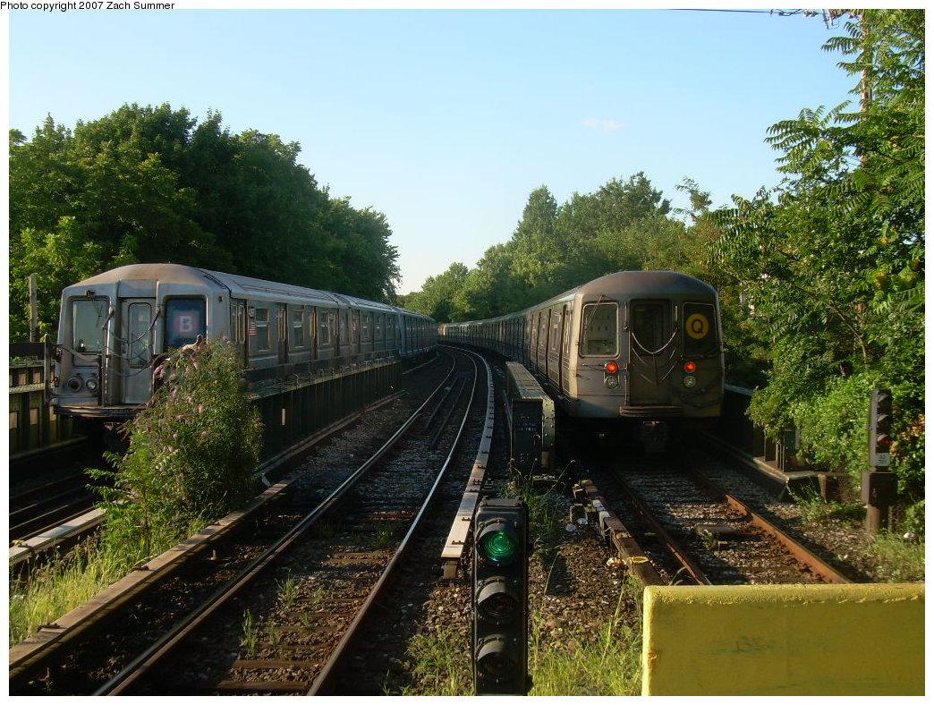 (276k, 1044x788)<br><b>Country:</b> United States<br><b>City:</b> New York<br><b>System:</b> New York City Transit<br><b>Line:</b> BMT Brighton Line<br><b>Location:</b> Sheepshead Bay<br><b>Route:</b> B<br><b>Car:</b> R-40 (St. Louis, 1968) 4297 <br><b>Photo by:</b> Zach Summer<br><b>Date:</b> 8/12/2007<br><b>Notes:</b> Layup train at Sheepshead Bay on left with northbound R68 Q train at right.<br><b>Viewed (this week/total):</b> 2 / 2981