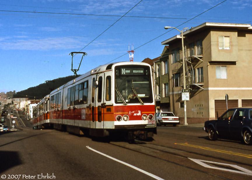 (184k, 864x617)<br><b>Country:</b> United States<br><b>City:</b> San Francisco/Bay Area, CA<br><b>System:</b> SF MUNI<br><b>Line:</b> MUNI Metro (N-Judah)<br><b>Location:</b> Judah/15th<br><b>Car:</b> MUNI Standard LRV (Boeing-Vertol, 1976-78) 1257 <br><b>Photo by:</b> Peter Ehrlich<br><b>Date:</b> 5/29/1990<br><b>Notes:</b> Judah/15th Avenue outbound.<br><b>Viewed (this week/total):</b> 0 / 838
