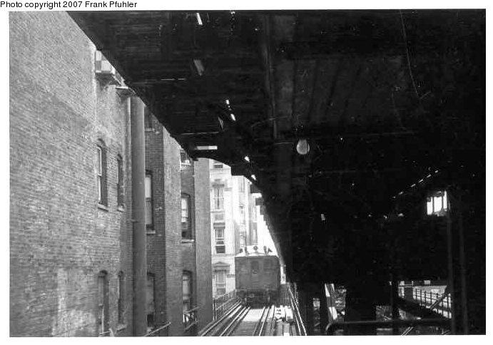 (61k, 691x484)<br><b>Country:</b> United States<br><b>City:</b> New York<br><b>System:</b> New York City Transit<br><b>Line:</b> 3rd Avenue El<br><b>Location:</b> 133rd Street<br><b>Photo by:</b> Frank Pfuhler<br><b>Date:</b> 1954<br><b>Notes:</b> View north to downtown MUDC Train approaching Bronx E.133rd St Lower Local Level Station with dual Express tracks above.<br><b>Viewed (this week/total):</b> 0 / 2581