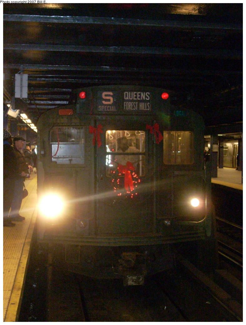(249k, 788x1044)<br><b>Country:</b> United States<br><b>City:</b> New York<br><b>System:</b> New York City Transit<br><b>Line:</b> IND Queens Boulevard Line<br><b>Location:</b> Queens Plaza<br><b>Route:</b> Museum Train Service (V)<br><b>Car:</b> R-9 (Pressed Steel, 1940) 1802 <br><b>Photo by:</b> Bill E.<br><b>Date:</b> 12/2/2007<br><b>Viewed (this week/total):</b> 2 / 2240