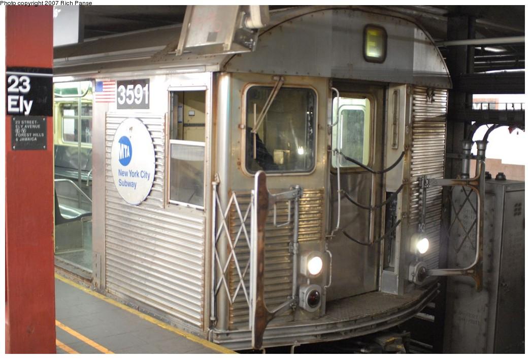 (172k, 1044x706)<br><b>Country:</b> United States<br><b>City:</b> New York<br><b>System:</b> New York City Transit<br><b>Line:</b> IND Queens Boulevard Line<br><b>Location:</b> Court Square/23rd St (Ely Avenue)<br><b>Route:</b> E<br><b>Car:</b> R-32 (Budd, 1964) 3591 <br><b>Photo by:</b> Richard Panse<br><b>Date:</b> 12/9/2007<br><b>Viewed (this week/total):</b> 5 / 3695
