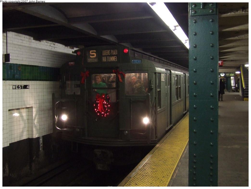 (182k, 1044x788)<br><b>Country:</b> United States<br><b>City:</b> New York<br><b>System:</b> New York City Transit<br><b>Line:</b> IND 6th Avenue Line<br><b>Location:</b> West 4th Street/Washington Square<br><b>Route:</b> Museum Train Service (V)<br><b>Car:</b> R-9 (Pressed Steel, 1940) 1802 <br><b>Photo by:</b> John Barnes<br><b>Date:</b> 12/16/2007<br><b>Notes:</b> Train in regular Nostalgia Train service - not technically a fan trip.<br><b>Viewed (this week/total):</b> 1 / 2517