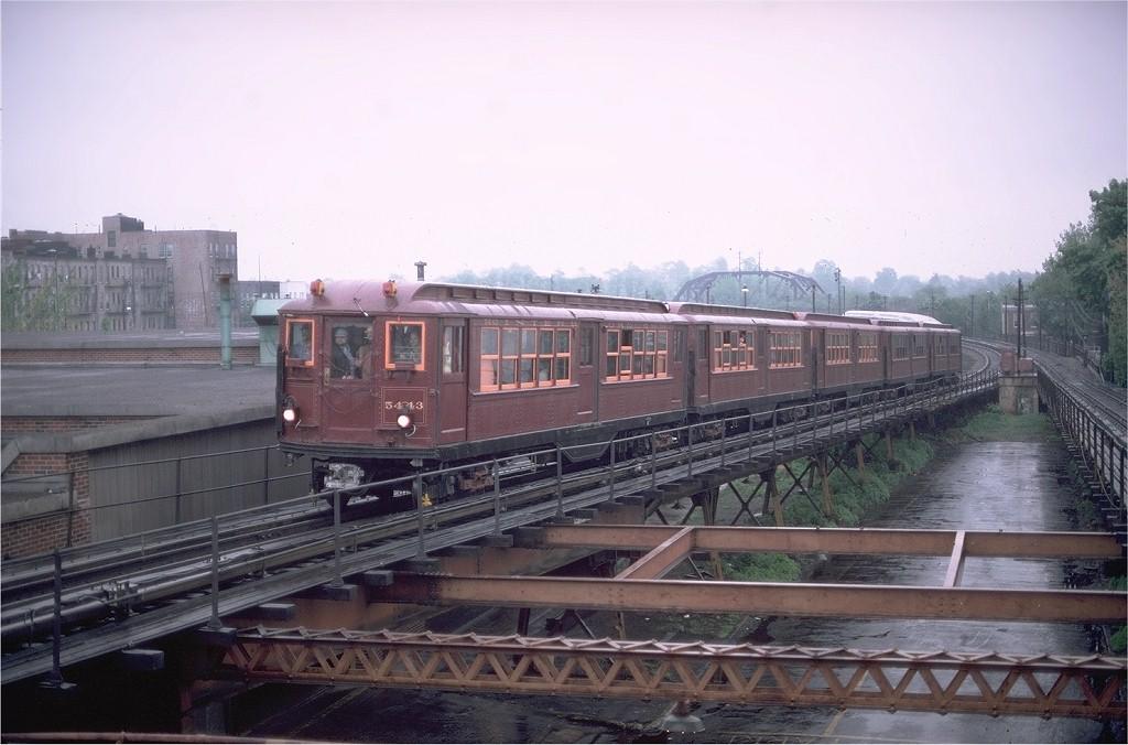 (169k, 1024x676)<br><b>Country:</b> United States<br><b>City:</b> New York<br><b>System:</b> New York City Transit<br><b>Line:</b> BMT Myrtle Avenue Line<br><b>Location:</b> Fresh Pond Road<br><b>Route:</b> Fan Trip<br><b>Car:</b> Low-V (Museum Train) 5443 <br><b>Photo by:</b> Gerald H. Landau<br><b>Collection of:</b> Joe Testagrose<br><b>Date:</b> 5/12/1979<br><b>Viewed (this week/total):</b> 0 / 5068