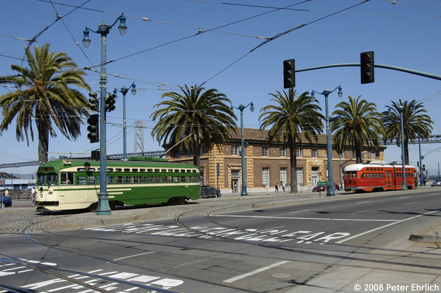 (211k, 864x574)<br><b>Country:</b> United States<br><b>City:</b> San Francisco/Bay Area, CA<br><b>System:</b> SF MUNI<br><b>Location:</b> Embarcadero/Ferry Plaza Layover<br><b>Route:</b> F-Market<br><b>Car:</b> SF MUNI PCC (Ex-SEPTA) (St. Louis Car Co., 1947-1948) 1050 <br><b>Photo by:</b> Peter Ehrlich<br><b>Date:</b> 6/11/2008<br><b>Notes:</b> Outbound car at Ferry Plaza.  With 1061 (Pacific Electric) on the layover track.<br><b>Viewed (this week/total):</b> 0 / 590