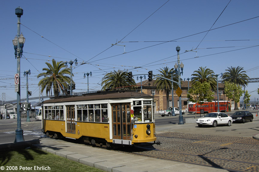 (189k, 864x574)<br><b>Country:</b> United States<br><b>City:</b> San Francisco/Bay Area, CA<br><b>System:</b> SF MUNI<br><b>Location:</b> Embarcadero/Ferry Plaza Layover<br><b>Route:</b> F-Market<br><b>Car:</b> Milan Milano/Peter Witt (1927-1930) 1811 <br><b>Photo by:</b> Peter Ehrlich<br><b>Date:</b> 6/11/2008<br><b>Notes:</b> Outbound car at Ferry Plaza.  With 1061 (Pacific Electric) on the layover track.<br><b>Viewed (this week/total):</b> 0 / 578