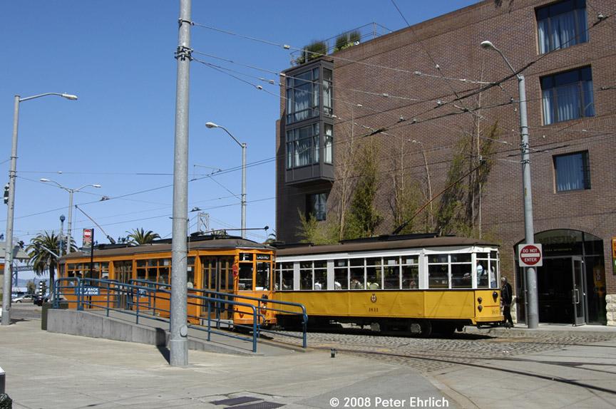 (202k, 864x574)<br><b>Country:</b> United States<br><b>City:</b> San Francisco/Bay Area, CA<br><b>System:</b> SF MUNI<br><b>Location:</b> Steuart/Don Chee Way<br><b>Route:</b> F-Market<br><b>Car:</b> Milan Milano/Peter Witt (1927-1930) 1893 <br><b>Photo by:</b> Peter Ehrlich<br><b>Date:</b> 6/11/2008<br><b>Notes:</b> Don Chee Way/Steuart outbound.   With 1811 (Milan 1928 yellow/white) inbound.<br><b>Viewed (this week/total):</b> 0 / 546