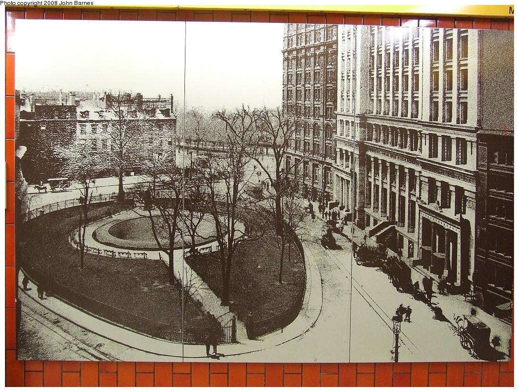 (380k, 1044x788)<br><b>Country:</b> United States<br><b>City:</b> New York<br><b>System:</b> New York City Transit<br><b>Line:</b> IRT East Side Line<br><b>Location:</b> Bowling Green<br><b>Photo by:</b> John Barnes<br><b>Date:</b> 8/26/2007<br><b>Artwork:</b> <i>Historic New York Photographs</i>, artist unknown<br><b>Notes:</b> Bowling Green and Lower Broadway 1898. Courtesy of New-York Historical Society, NYC.<br><b>Viewed (this week/total):</b> 1 / 2439