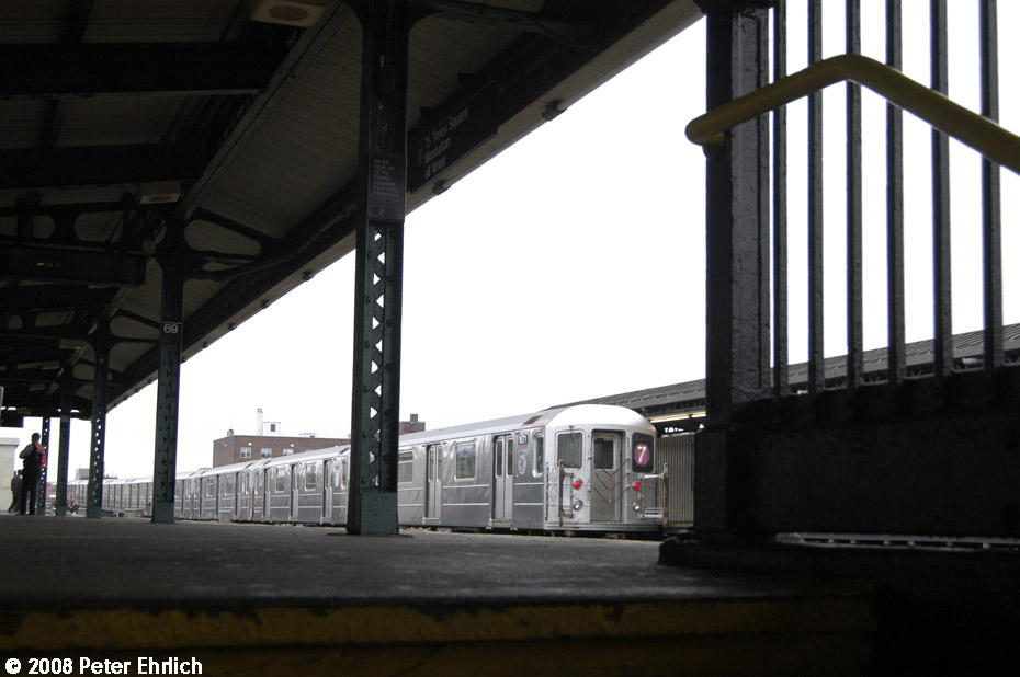 (143k, 930x618)<br><b>Country:</b> United States<br><b>City:</b> New York<br><b>System:</b> New York City Transit<br><b>Line:</b> IRT Flushing Line<br><b>Location:</b> 69th Street/Fisk Avenue<br><b>Route:</b> 7<br><b>Car:</b> R-62A (Bombardier, 1984-1987) 1671 <br><b>Photo by:</b> Peter Ehrlich<br><b>Date:</b> 9/28/2008<br><b>Notes:</b> 69 Street-Fisk Avenue, outbound train.<br><b>Viewed (this week/total):</b> 7 / 2142