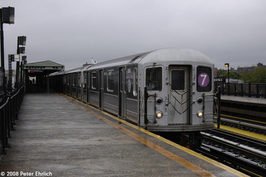 (174k, 930x618)<br><b>Country:</b> United States<br><b>City:</b> New York<br><b>System:</b> New York City Transit<br><b>Line:</b> IRT Flushing Line<br><b>Location:</b> 69th Street/Fisk Avenue<br><b>Route:</b> 7<br><b>Car:</b> R-62A (Bombardier, 1984-1987) 1696 <br><b>Photo by:</b> Peter Ehrlich<br><b>Date:</b> 9/28/2008<br><b>Notes:</b> 69 Street-Fisk Avenue, inbound train.<br><b>Viewed (this week/total):</b> 4 / 1685