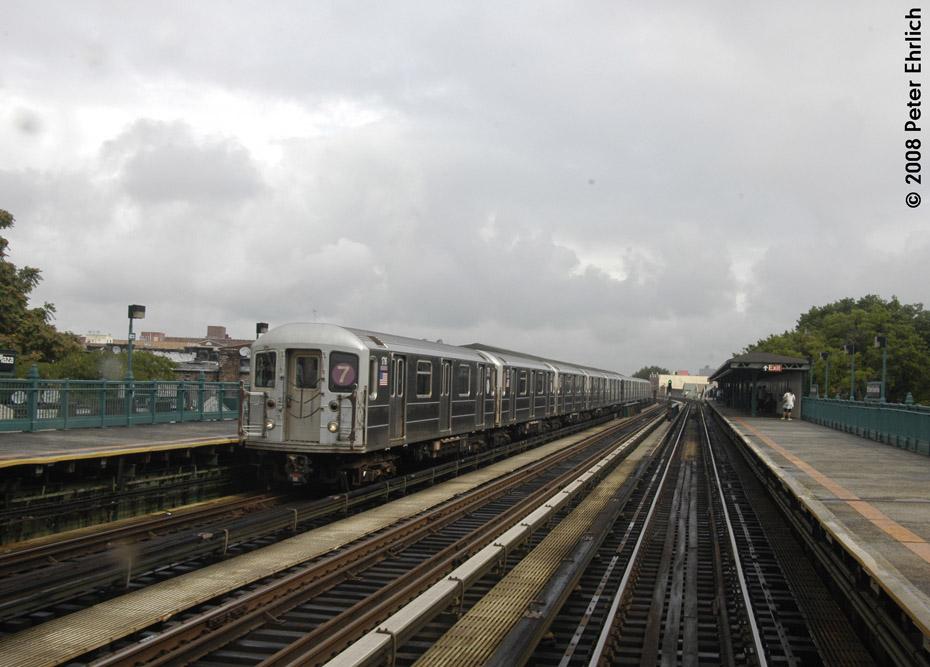 (176k, 930x667)<br><b>Country:</b> United States<br><b>City:</b> New York<br><b>System:</b> New York City Transit<br><b>Line:</b> IRT Flushing Line<br><b>Location:</b> 103rd Street/Corona Plaza<br><b>Route:</b> 7<br><b>Car:</b> R-62A (Bombardier, 1984-1987) 1716 <br><b>Photo by:</b> Peter Ehrlich<br><b>Date:</b> 9/28/2008<br><b>Notes:</b> 103 St-Corona Plaza, inbound train.<br><b>Viewed (this week/total):</b> 4 / 1817