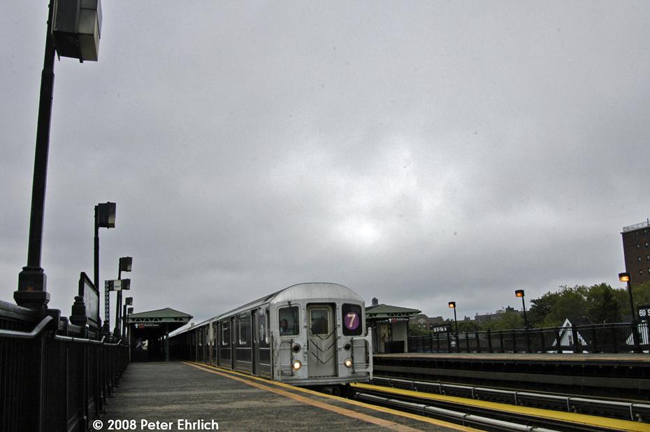 (516k, 930x618)<br><b>Country:</b> United States<br><b>City:</b> New York<br><b>System:</b> New York City Transit<br><b>Line:</b> IRT Flushing Line<br><b>Location:</b> 69th Street/Fisk Avenue<br><b>Route:</b> 7<br><b>Car:</b> R-62A (Bombardier, 1984-1987) 1736 <br><b>Photo by:</b> Peter Ehrlich<br><b>Date:</b> 9/28/2008<br><b>Notes:</b> 69 Street-Fisk Avenue, inbound train.<br><b>Viewed (this week/total):</b> 1 / 1694