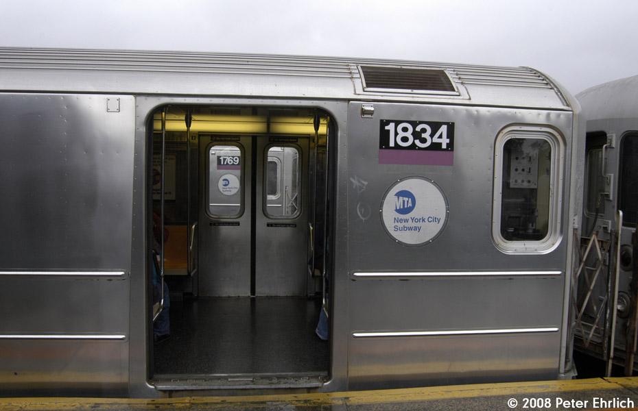 (148k, 930x600)<br><b>Country:</b> United States<br><b>City:</b> New York<br><b>System:</b> New York City Transit<br><b>Line:</b> IRT Flushing Line<br><b>Location:</b> 103rd Street/Corona Plaza<br><b>Route:</b> 7<br><b>Car:</b> R-62A (Bombardier, 1984-1987) 1834 <br><b>Photo by:</b> Peter Ehrlich<br><b>Date:</b> 9/28/2008<br><b>Notes:</b> 103 St-Corona Plaza inbound.  1769, outbound, is visible through the doors.<br><b>Viewed (this week/total):</b> 7 / 2432