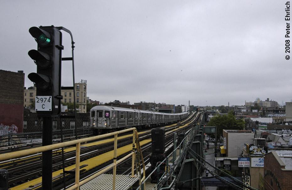 (175k, 930x608)<br><b>Country:</b> United States<br><b>City:</b> New York<br><b>System:</b> New York City Transit<br><b>Line:</b> IRT Flushing Line<br><b>Location:</b> 69th Street/Fisk Avenue<br><b>Route:</b> 7<br><b>Car:</b> R-62A (Bombardier, 1984-1987) 2135 <br><b>Photo by:</b> Peter Ehrlich<br><b>Date:</b> 9/28/2008<br><b>Notes:</b> 69 Street-Fisk Avenue, outbound train.<br><b>Viewed (this week/total):</b> 2 / 1671