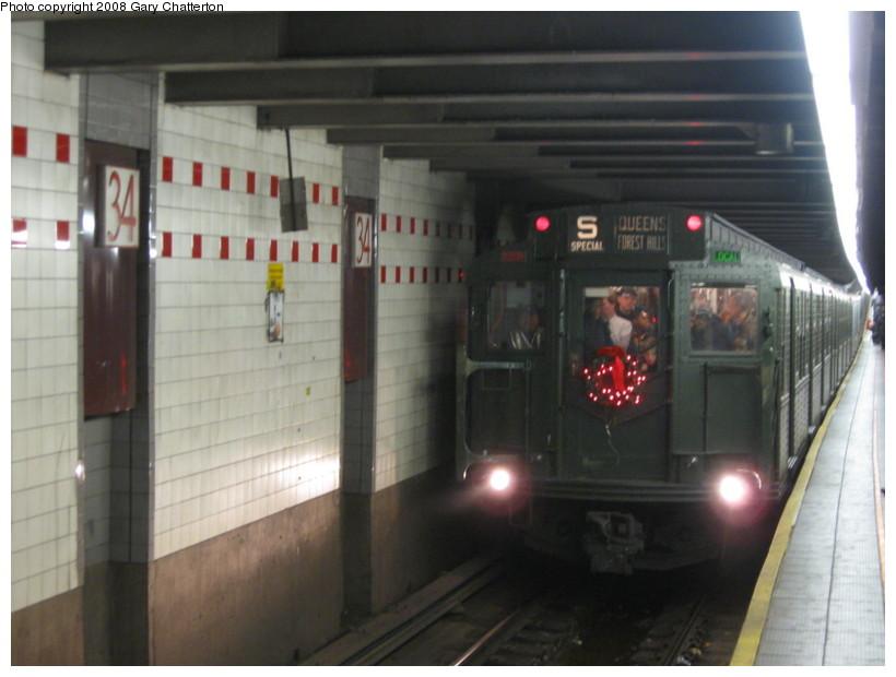(106k, 820x620)<br><b>Country:</b> United States<br><b>City:</b> New York<br><b>System:</b> New York City Transit<br><b>Line:</b> IND 6th Avenue Line<br><b>Location:</b> 34th Street/Herald Square<br><b>Route:</b> Museum Train Service (V)<br><b>Car:</b> R-1 (American Car & Foundry, 1930-1931) 100 <br><b>Photo by:</b> Gary Chatterton<br><b>Date:</b> 11/30/2008<br><b>Viewed (this week/total):</b> 0 / 2246