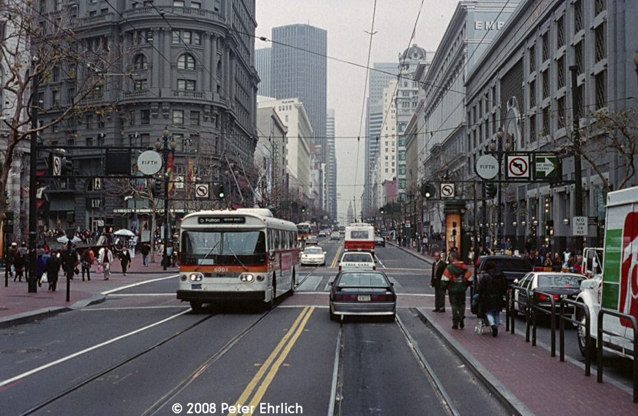 (245k, 930x607)<br><b>Country:</b> United States<br><b>City:</b> San Francisco/Bay Area, CA<br><b>System:</b> SF MUNI<br><b>Line:</b> SF MUNI Trolley Coach Routes<br><b>Car:</b> SF MUNI Trolley Coach (Flyer E700A, 1973) 5001 <br><b>Photo by:</b> Peter Ehrlich<br><b>Date:</b> 1/9/1996<br><b>Notes:</b> Line 21-Hayes outbound at Market & 5th.  One of just two Flyer E700As on the roster.<br><b>Viewed (this week/total):</b> 4 / 1617