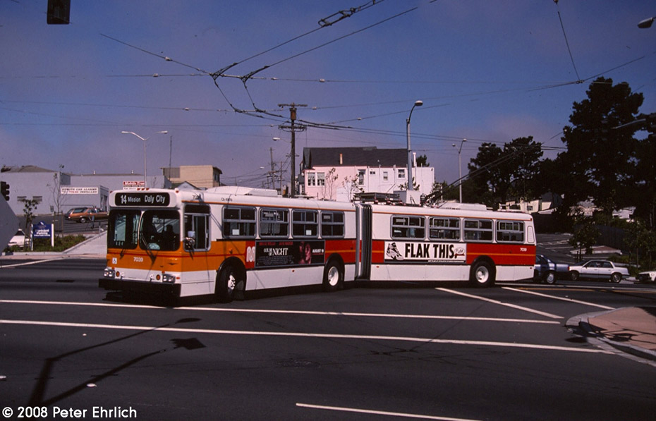 (170k, 930x597)<br><b>Country:</b> United States<br><b>City:</b> San Francisco/Bay Area, CA<br><b>System:</b> SF MUNI<br><b>Line:</b> SF MUNI Trolley Coach Routes<br><b>Car:</b> SF MUNI Trolley Coach (Flyer E60, 1992-94) 7039 <br><b>Photo by:</b> Peter Ehrlich<br><b>Date:</b> 8/20/1994<br><b>Notes:</b> New New Flyer E60 artic trolleycoach. Mission/San Jose, aka Top Of The Hill, Daly City, approaching line 14-Mission outer terminal.<br><b>Viewed (this week/total):</b> 0 / 673