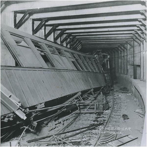 (115k, 600x600)<br><b>Country:</b> United States<br><b>City:</b> New York<br><b>System:</b> New York City Transit<br><b>Line:</b> BMT Franklin Shuttle<br><b>Location:</b> Empire Blvd. (Malbone St.) Tunnel Portal<br><b>Car:</b> BMT Elevated Gate Car 100 <br><b>Collection of:</b> NYCTA File Photo<br><b>Date:</b> 11/2/1918<br><b>Notes:</b> Malbone Street accident.<br><b>Viewed (this week/total):</b> 11 / 9010
