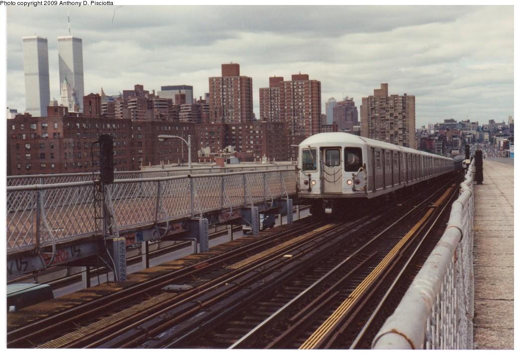 (196k, 1044x717)<br><b>Country:</b> United States<br><b>City:</b> New York<br><b>System:</b> New York City Transit<br><b>Line:</b> BMT Nassau Street-Jamaica Line<br><b>Location:</b> Williamsburg Bridge<br><b>Route:</b> J<br><b>Car:</b> R-42 (St. Louis, 1969-1970)  <br><b>Photo by:</b> Anthony D. Pisciotta<br><b>Notes:</b> Williamsburg Bridge Brooklyn bound J about 1988.<br><b>Viewed (this week/total):</b> 5 / 3427