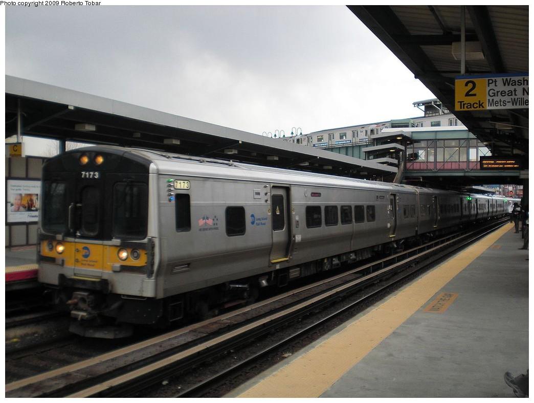 (209k, 1044x788)<br><b>Country:</b> United States<br><b>City:</b> New York<br><b>System:</b> Long Island Rail Road<br><b>Line:</b> LIRR Main Line<br><b>Location:</b> Woodside<br><b>Car:</b> LIRR M-7 EMU (Bombardier) 7173 <br><b>Photo by:</b> Roberto C. Tobar<br><b>Date:</b> 4/8/2009<br><b>Viewed (this week/total):</b> 0 / 625